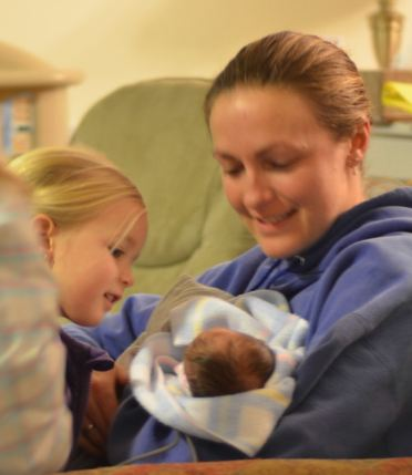 Ellery and Amber holding Alexandria